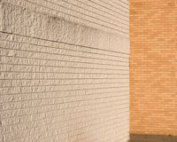 White and natural brick walls meeting Royalty Free Stock Image