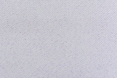 White natural linen fabric with brilliance lurex close-up. Aida texture for the background Royalty Free Stock Photos