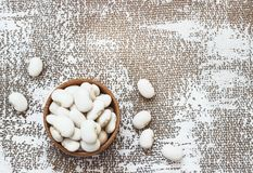 White navy beans in wooden bowl, also haricot, pearl haricot, boston, white or pea bean. Dried seeds of Phaseolus stock photography
