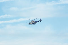 White and Navy Police helicopter. Stock Photo