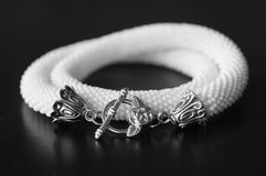 White necklace against a dark background Royalty Free Stock Photography
