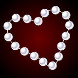 White necklace in the shape of heart Stock Image