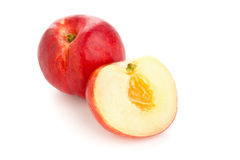 White nectarine whole and sliced over white Royalty Free Stock Photography