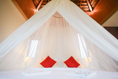 White net dome over bed, romantic room Stock Photos