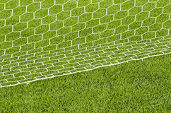 The white Net marking on the artificial green grass soccer field Stock Photos