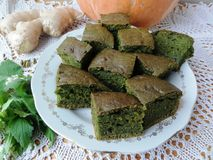 White nettle ginger pumpkin cake. Dead-nettle, wild plants recipes, cooking healthy food royalty free stock image