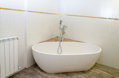 White new bath, white tiles and the battery in the mikvah Stock Photography