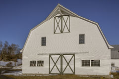 White New England Horse Barn Vermont. A white and green painted traditonal New England horse barn in Vermont at sunset Royalty Free Stock Images