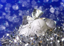 White New Year's balls and tinsel on a blue background Stock Images