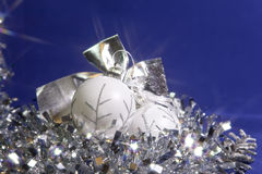 White New Year's balls and tinsel on a blue background Royalty Free Stock Images