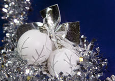 White New Year's balls and tinsel on a blue background Stock Image