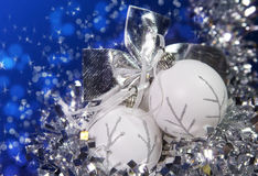 White New Year's balls and tinsel on a blue background Stock Photography