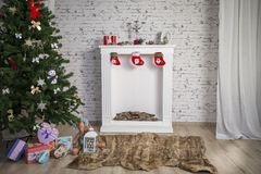 White New Year`s interior with fireplace and green tree Stock Photos