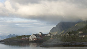 White night in fishing village on Norwegian fjord Stock Photo