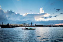 White night on the Neva River, pleasure boat and rostral column Stock Images