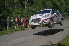 White Night Rally 2013. Karelia, Russia, 26 June 2013: Driver Sergey Tambovtsev  jump at PEUGEOT 208 R2 in White Night Rally 2013 Stock Photos