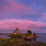 White Night On The White Sea Coast. Village Rabocheostrovsk, Republic Of Karelia. Old Russian Orthodox Wooden Church On Island Royalty Free Stock Images