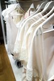 White nightgowns hang in store. A white nightgowns hang in the store Royalty Free Stock Image