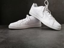 White nike shoes stock photography