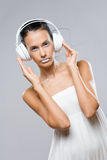 White noise, brunette with headphones. Royalty Free Stock Photo