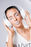 White noise, brunette with headphones. Stock Image