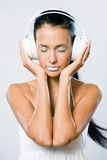 White noise, brunette with headphones. Royalty Free Stock Photos
