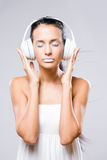 White noise, brunette with headphones. Royalty Free Stock Images