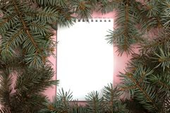 White note book with Chistmas tree branches around royalty free stock image