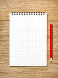 A white note book with lots of room for your text or image and a Royalty Free Stock Images