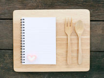 The white note book and wooden board on old deep brown planks Stock Photo