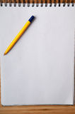 White note pad. Blank white note pad and pen for writing new ideas Stock Photography