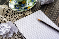 White note pad and pencil on table Stock Photo