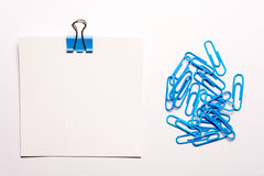 White note paper and blue paperclips Royalty Free Stock Image