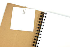 White note paper on brown cover note book Stock Image