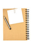 White note paper on brown cover note book with pen Stock Images