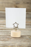White note paper on a holder on wooden background Stock Image