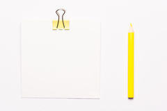 White note paper and yellow paperclips Stock Images
