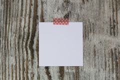 White note in a wood background Stock Photos