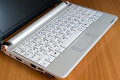 White notebook. Close-up of a laptop computer on the wooden table Stock Photo