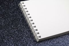 White notebook with blank sheets on black. stock image