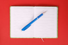 White notebook and blue pen. Green open notebook with blue pen isolated on white background red soft shadow Clipping path Stock Photos