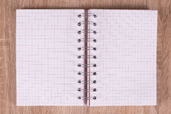 White notebook. On a board Royalty Free Stock Images