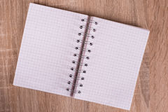 White notebook. On a board Royalty Free Stock Photos