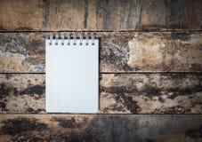 white notebook on grunge wood Royalty Free Stock Image