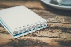 white notebook on grunge wood Stock Photos