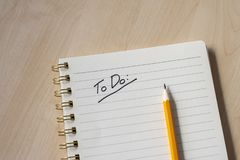 white notebook with notes and wooden desk royalty free stock images