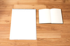 White Notebook papers with Wood Background Stock Photo