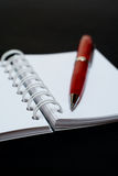 White notebook and pen. On white background royalty free stock photo