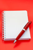 White notebook and pen stock image