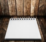 White notebook on wood Stock Photos